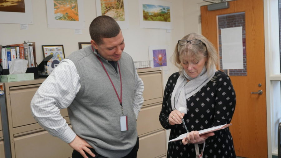 Making friends-- IAR Principal Scott Hurwitz speaks with Information Literacy and Learning Departmant Chair Kelly Stokoe during a recent visit to the high school. Hurwitz formerly worked for Glastonbury Public Schools before becoming the current IAR principal in Farmington.