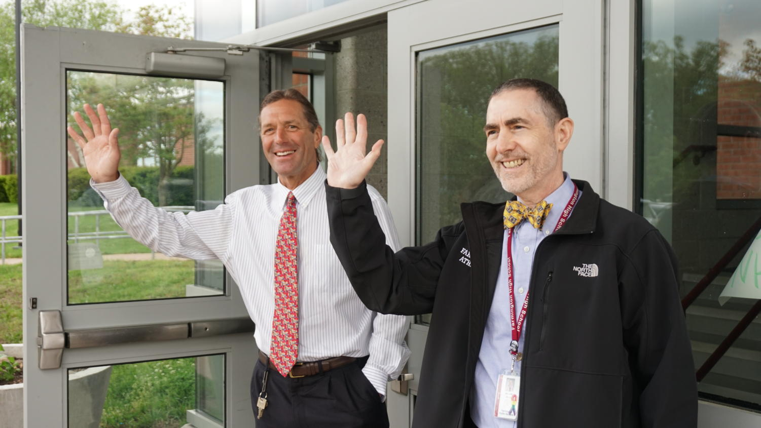 """You say 'goodbye' and I say 'hello'""-- (left to right) Assistant Principal Curt Pandiscio and Principal Bill Silva greet students, faculty, and staff in the morning outside the Student Entrance of the high school. Both Pandiscio and Silva announced their retirement earlier this year."