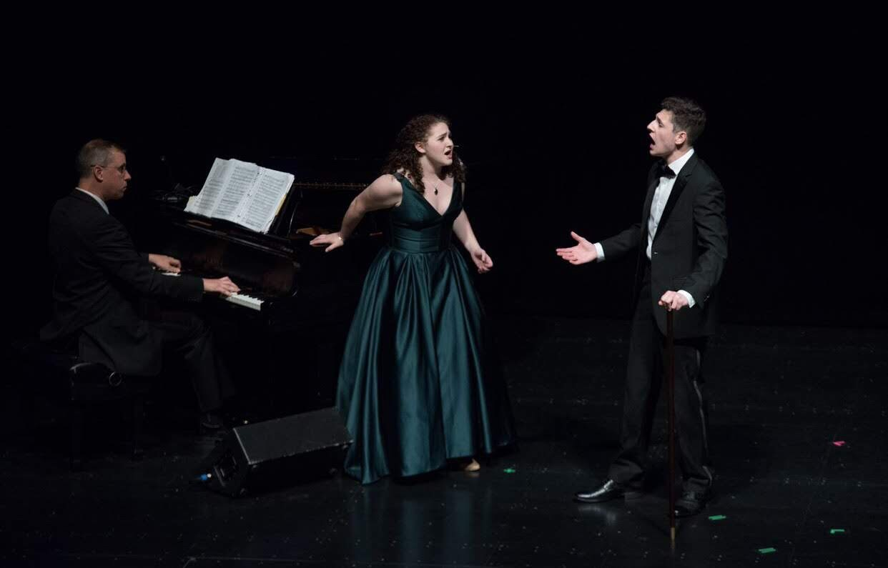 "Perfect notes-- Senior Camille Hoheb (center) sings the song ""Imponente"" on stage in Belding Theater, which is located in Hartford. Hoheb will major in vocal performance at the University of Connecticut in the fall."