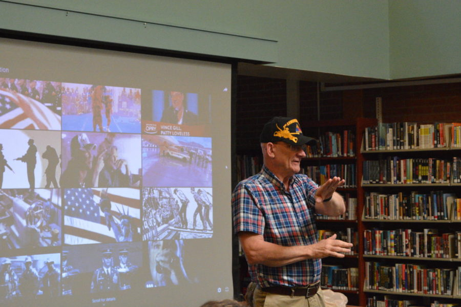Honorable+service+--+Former+math+teacher+and+Vietnam-era+veteran+Bob+Thomas+presents+to+a+group+of+students+during+the+veterans+celebration+in+the+library.+Senior+Ashley+Dummit+organized+the+event%2C+which%0Atoo+place+on+May+21+and+May+22.