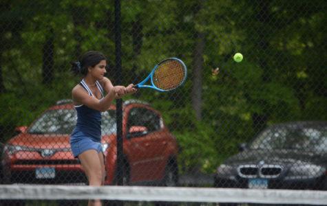 Boys, girls tennis teams end regular season with success