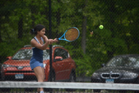 Boys, girls tennis teams end regular season with success