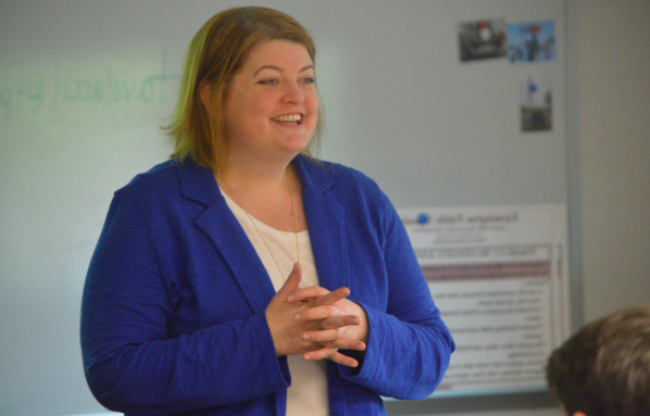 Ready to speak -- Social studies teacher Meg Monaghan debriefs with her Advanced Placement United States History (APUSH) students the day after the exam. Monaghan was voted as the senior class graduation speaker. Graduation will take place at 6 p.m. on June 12 on the high school turf field.