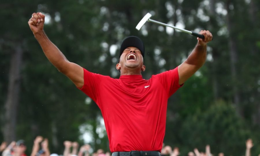 The+joy+of+triumph--+Tiger+Woods+throws+his+hands+up+for+joy+as+he+realizes+he+just+won+the+biggest+golf+tournament+in+the%0Aworld.+This+was+Tiger%E2%80%99s+first+Masters+Tournament+win+since+2005.