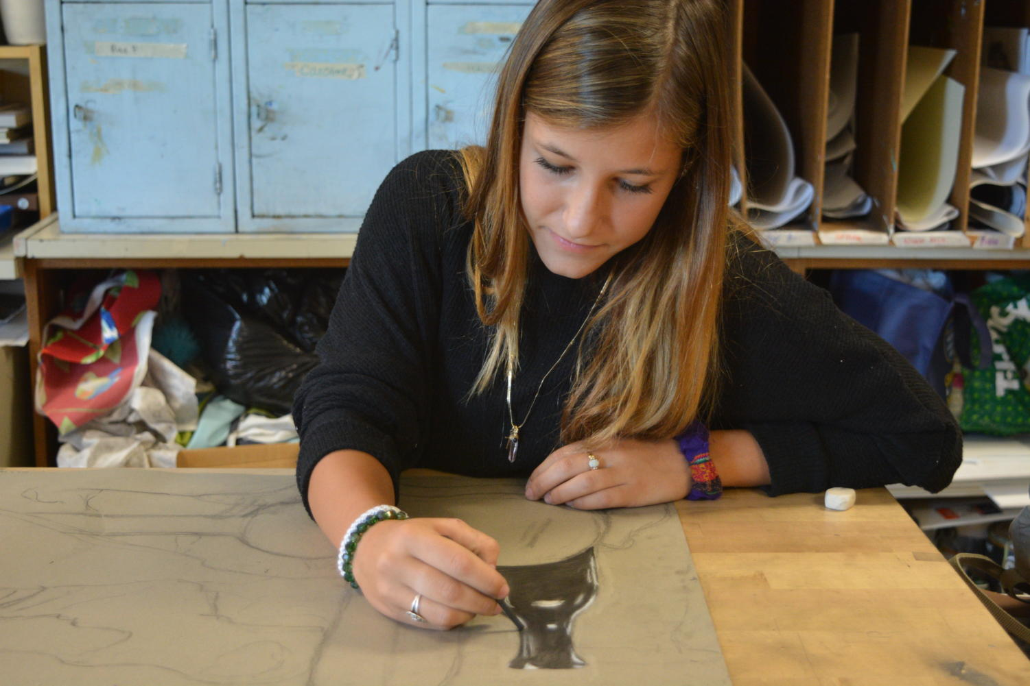 Creative mind-- Junior Elle Henry works on her still life sketch. Henry is a student in Art teacher Katarina McKinney's Art I class.