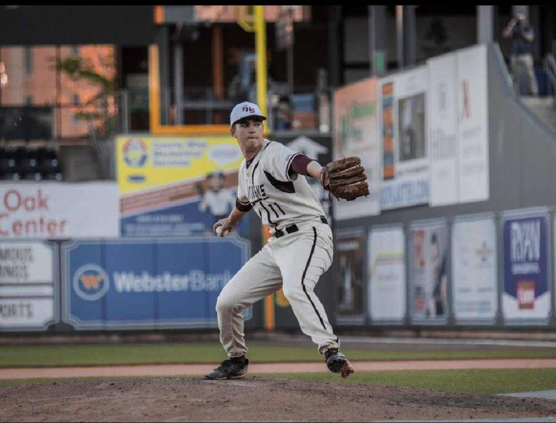 Committed-- Senior Tyler Cortland fires a pitch against Northwest Catholic on May 8 at Dunkin Donuts Park. Cortland will attend Dartmouth College in the fall.