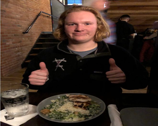 Dinner is served-- Junior Cullen Laberge enjoys a meal at the newly located Wood-n-Tap location. The restaurant has moved right across the street from the high school.