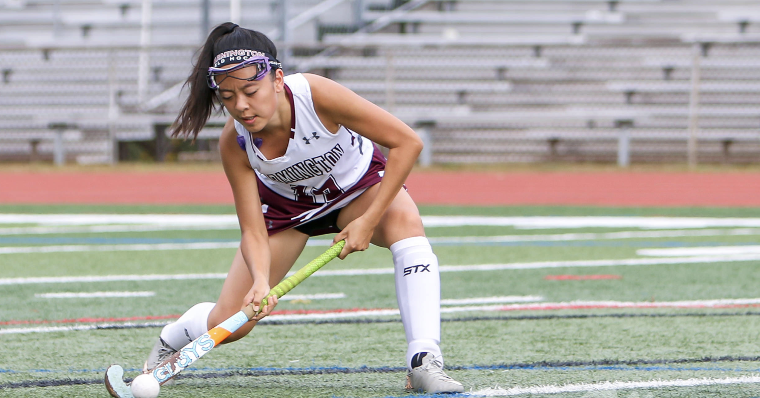 Shot and a score-- Senior Karen Ru swipes with her field hockey stick across the field for the score. The team had a successful regular season and are excited for the future.