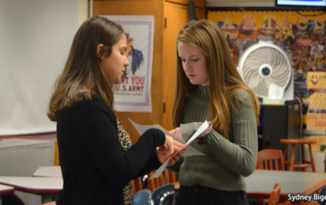 Privilege walk workers-- Sophomores Olivia Heckman (right) and Rachel Wolkoff (left) collaborate before their privilege walk on December 6. The walk was hosted a part of the empowerment project in order to raise awareness of American privilege.