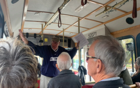 Hitchin' a ride -- Unionville community members receive a guided tour from the Unionville trolley. The tour provided information about the town and the roll trollies once played in the community.