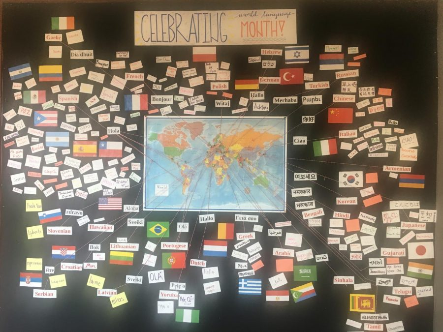 On+display--+World+language+students+create+a+bulletin+board+outside+the+library+to+celebrate+World+Language+Month.+This+month+helps+to+bring+together+the+diversity+of+languages+and+culture.+