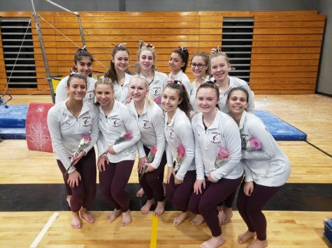 Pose for a picture -- (Bottom row left to right) Junior Lily Roy, seniors Lizzie Kot, Anna Mihalek, Gabby Butler, junior Lindsay Smith, freshman Seraphim Walker, and (top row left to right) sophomore Noelle Ciravolo, freshman Kelly Harris, sophomore McKenna Brenwald, juniors Sophia Botalico, Olivia Pare, and freshman Olivia Palewicz pose for a picture after placing sixth at States. The meet took place on February 29 at Jonothan Law High School.