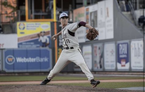 FHS senior Tyler winds up to pitch during a 2019 game at Dunkin Donuts Park.