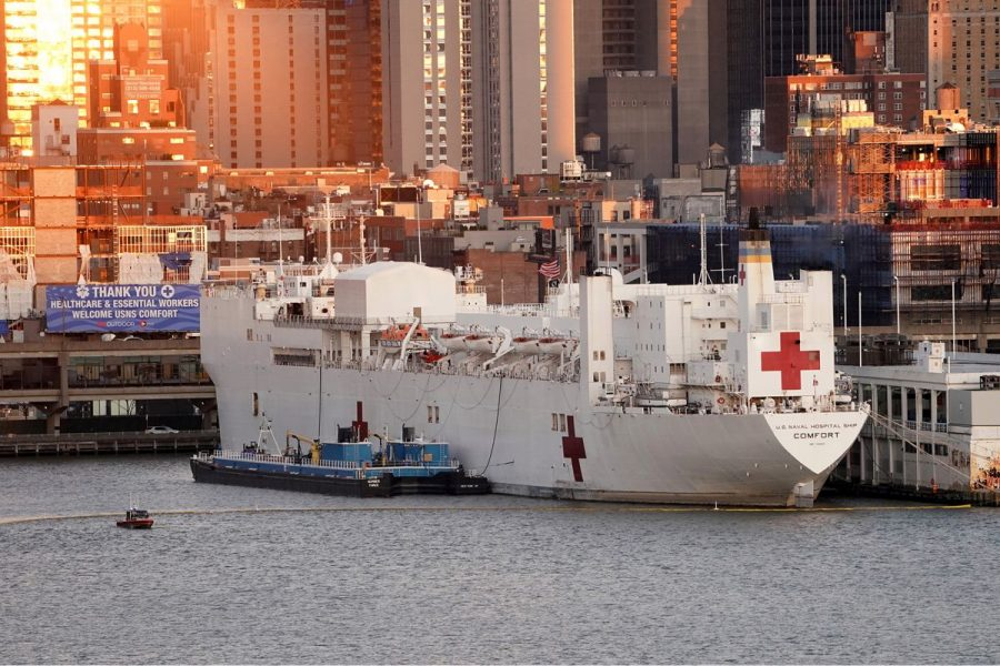Helping hand-- The USNS Comfort docks at Pier 90 in New York City on March 30, to relieve nearby hospi- tals. The ship is needed for extra hospital space due to the recent COVID-19 outbreak.
