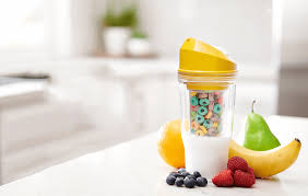 Breakfast on the go-- The yellow Crunch Cup is one of three flavors available, the other two being pink and blue. The Crunch Cup is the perfect way to enjoy cereal on-the-go as it ensures that you do not have soggy cereal, releasing the perfect cereal to milk ratio upon sip.