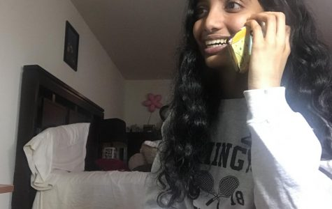 Only one call away -- Junior Saathvika Diviti speaks with a Farmington senior citizen over the phone. Diviti and other students are able to volunteer and support members of the community during the COVID-19 pandemic.
