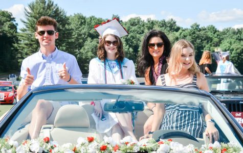 Drive-thru diploma-- (left to right) Junior Ricky Podgorski, senior Sofia Podgorski, parent Amy Podgorski, and 2018 alumna Bella Podgorski celebrate graduation from their car. Graduation was held on June 14 at the Farmington Polo Grounds in a drive-thru format due to the COVID-19 pandemic.