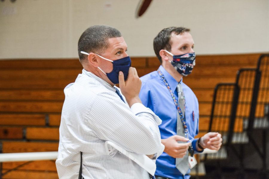 Looking on-- Principal Scott Hurwitz (left) and social studies teacher Patrick Mulcahy (right) look on as the final round of the Kahoot Competition takes place. Junior Abhi Yammanuru won the competition.