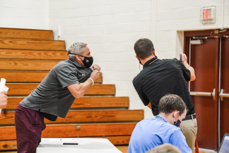 Show off-- Coach Chris Machol hypes up virtual onlookers during the schoolwide Kahoot competition. Machol was the winner of the teacher Kahoot Competition and played against one student from each grade level.