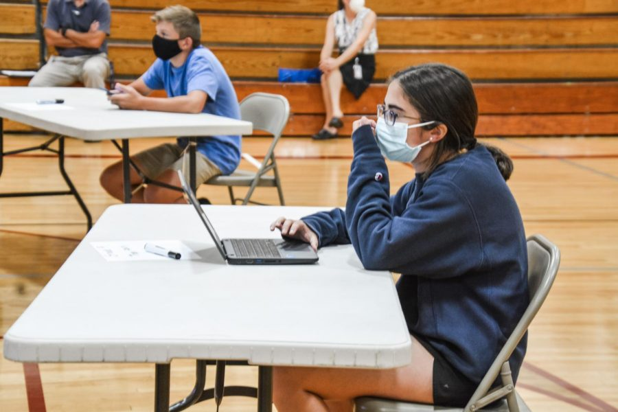 Ready to play-- Freshman Thea Fleury competes in the final round of the Kahoot Competition. Fleury was one of four grade-level reps who participated in the last round.