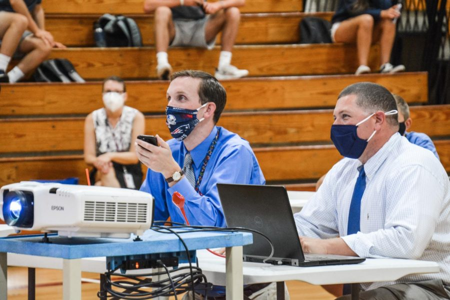 In control-- Social studies teacher Patrick Mulcahy and Principal Scott Hurwitz facilitate the last round of the Kahoot Competition. Mulcahy helped coordinate the event alongside Student Activities Director Chris Loomis and class advisers.