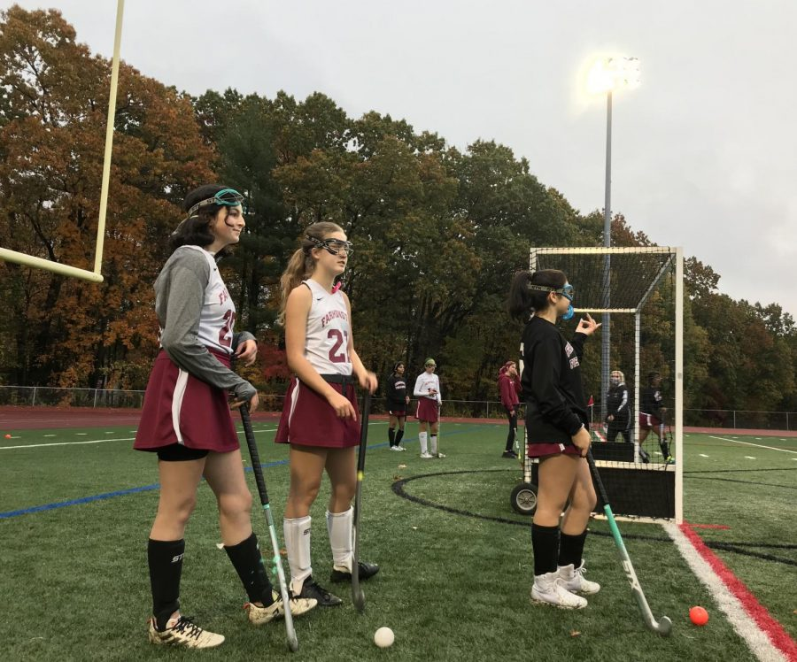 Safe for sports -- Field hockey players prepare for a game amidst the COVID-19 pandemic. Many athletes in different programs have opted out of in-person learning, but have continued to participate in sports.