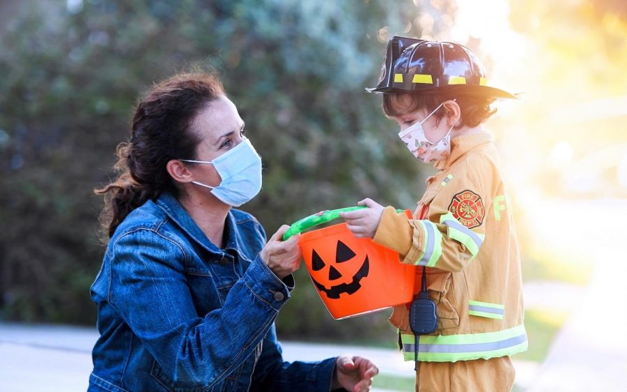 A+mask+for+every+costume+--+Halloween+traditions+around+the+country+have+been+adapted+in+order+to+follow+health+and+safety+protocols.+Wearing+a+mask+is+crucial+to+limit+the+spread+of+the+COVID-19+virus.+