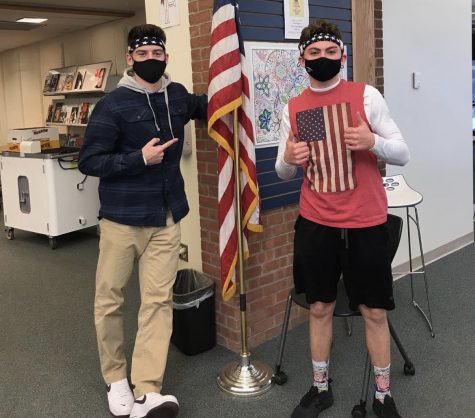 "USA pride, school spirit -- Seniors Joey Guglielmo and Ricky Podgorski find a flag to match their red, white, and blue apparel. ""USA day"" was celebrated as part of this years spirit week."