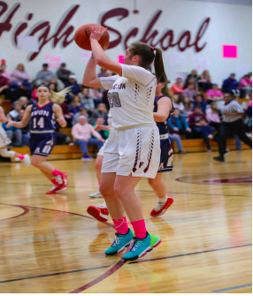 Swish Shot -- Novajasky lines up at the top of the three point arc and puts up a shot. Novajasky looks to lead Farmington to another successful season on the court while striving toward her lifelong goal of scoring 1,000 points in her high school career.
