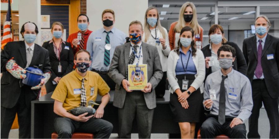Bears, Beets, Battlestar Galactica-- (left to right) BACK: Social studies teachers Emily Blanchard (Kevin), Sylvia Daleb (Jan), Dave Greenberg (Andy), Ted Bremer (Toby), Emma Tuthill (Angela), Lindsay Tavolacci (Holly), Meg  Monaghan (Karen), Jeff Gawle (Todd Packer), FRONT: Patrick Mulcahy (Dwight), Joel Nick (Michael Scott), Amanda Roller (Pam), James Dinnan (Jim) come together as member of The Office. Teachers participate alongside stu- dents for the holiday.