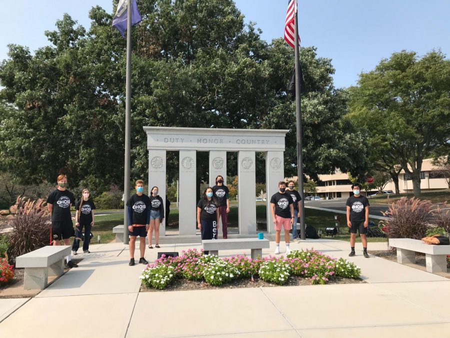 You can't stop the music -- Choir students participate in a concert outside of the Town Hall Veteran memorial. Students and teachers in band, choir, and orchestra have persevered to learn and teach during the pandemic.