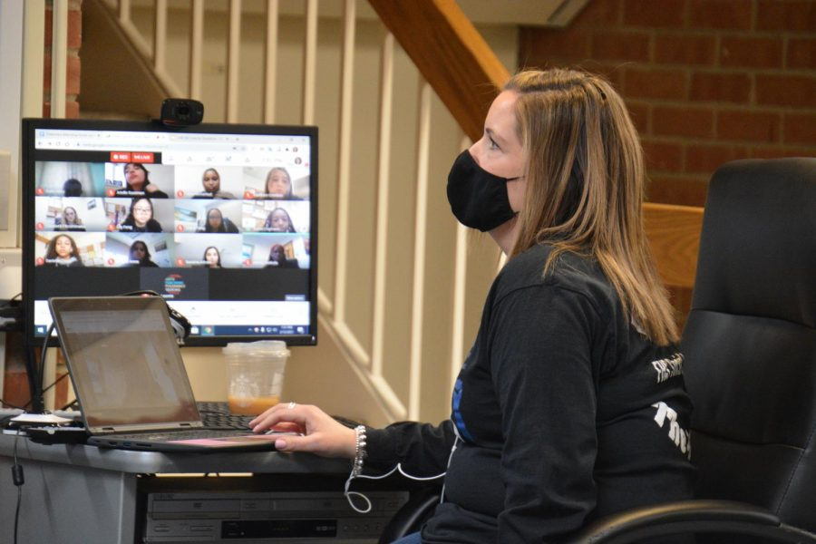 Connecting virtually - Library Media specialist Jessica-Lynn Johnson monitors the computer during a virtual presentation. The council had to take advantage of online platforms to give their presentations.