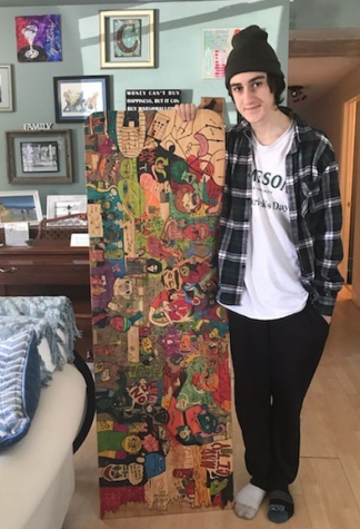 A true creator-- Senior Jameson Canny shows off his quarantine work. During quarantine, Canny used a piece of wood as his homework and drawing desk, which he covered with various doodles.