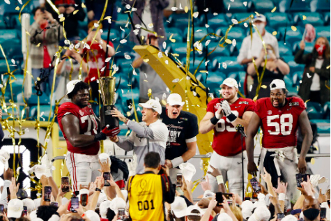 Best of the Best -- Alabama senior Alex Leatherwood and head coach Nick Saban lift the College Football Playoff National Championship trophy, after completing a 52-24 victory over Ohio State on January 11. The triumph marks Alabama's third victory in the last five years and eighteenth of all time.