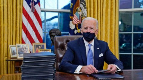 Planning ahead-- President Joe Biden sits in the Oval Office signing executive orders with his administration. Biden was inaugurated into office alongside Vice President Kamala Harris on January 20.