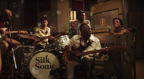"Walking through the Door: Bruno Mars (keyboard) and Anderson .Paak (drums) perform their new single ""Leave the Door Open"". The two artists have joined forces to create the group ""Silk Sonic"", an homage to the R&B and soul groups that acted as the primary influence for their musical passion."