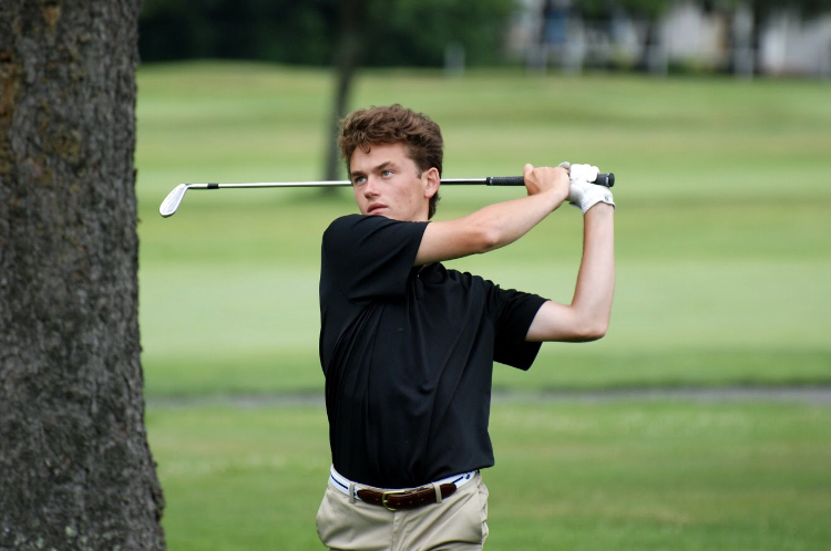 Pursuing+perfection+--+2021+Boys+Golf+captain+John+Guerrera+plays+his+approach+to+the+second+green+in+the+2020+Connecticut+Junior+Amatuer+Championship+at+the+Watertown+Country+Club.+Guerrera+has+been+named+an+All-Central+Connecticut+Conference+athlete+twice+during+his+time+on+the+team.+%0A