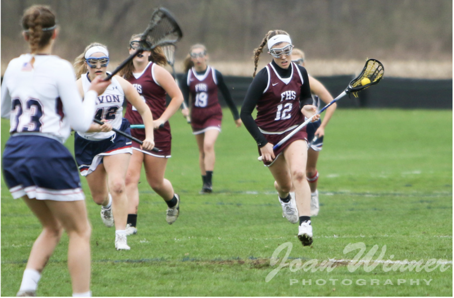 Cruise control -- Junior Liz Neri cruises past defenders and brings the ball up the field in a 2019 away game against Avon. Neri is a tri- sport athlete and is currently preparing for a breakout junior lacrosse season.