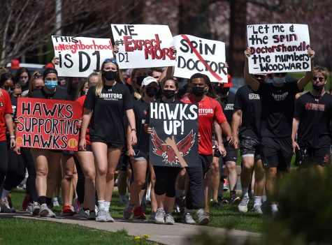 A disappointing Division decision -- University of Hartford students and athletes march with signs expressing their disapproval of the schools decision to move to the NCAA Division III. The school announced their decision in May 2021 but will not file their intent until January of 2022.
