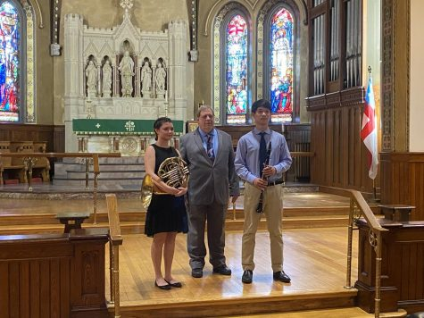 Hard work pays off -- After weeks of preparation, senior Andy Dong (right) performed for the Nutmeg Symphony Orchestras Young Artist Competition. The competition was hosted at Trinity Episcopal Church and organized by Marshall Brown (middle).