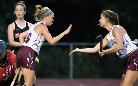 Give me five — Senior Delaney Dopp (left) reaches to high-five sophomore Anna Loughman (right) after scoring one of five goals for the River Hawks against E.O. Smith. The team stands at 4 wins and 0 losses.