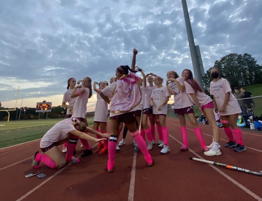 Playing for a cure — Senior captain Sonali Patel stands in front of the field hockey team, all dressed in pink to support breast cancer awareness. Patel scored one of the two goals in the 2-0 win against Pomperaug.
